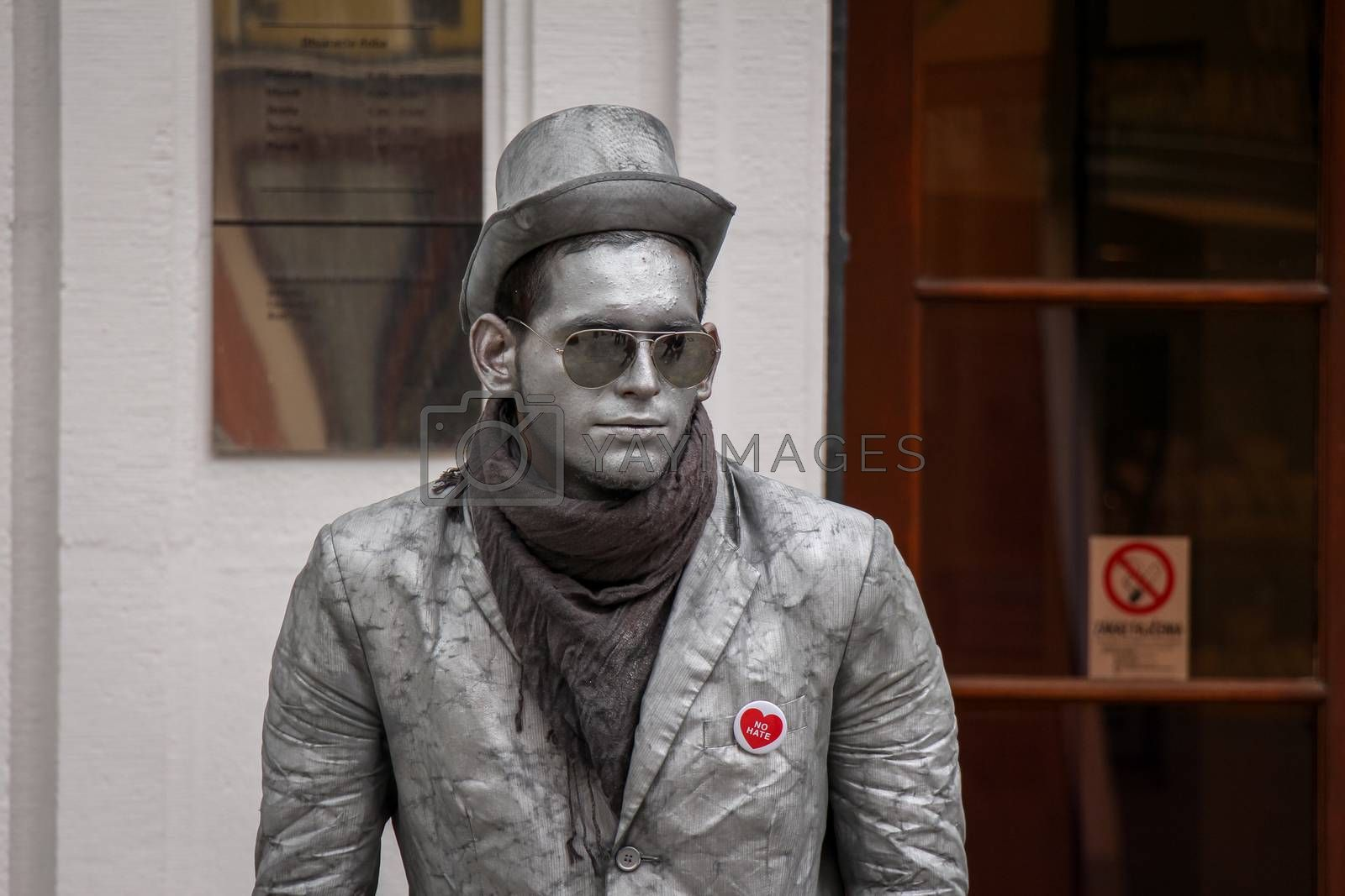 Bratislava, Slovakia - July 5th 2020: A street performer mimicking the silver statues in the old town in Bratislava, Slovakia