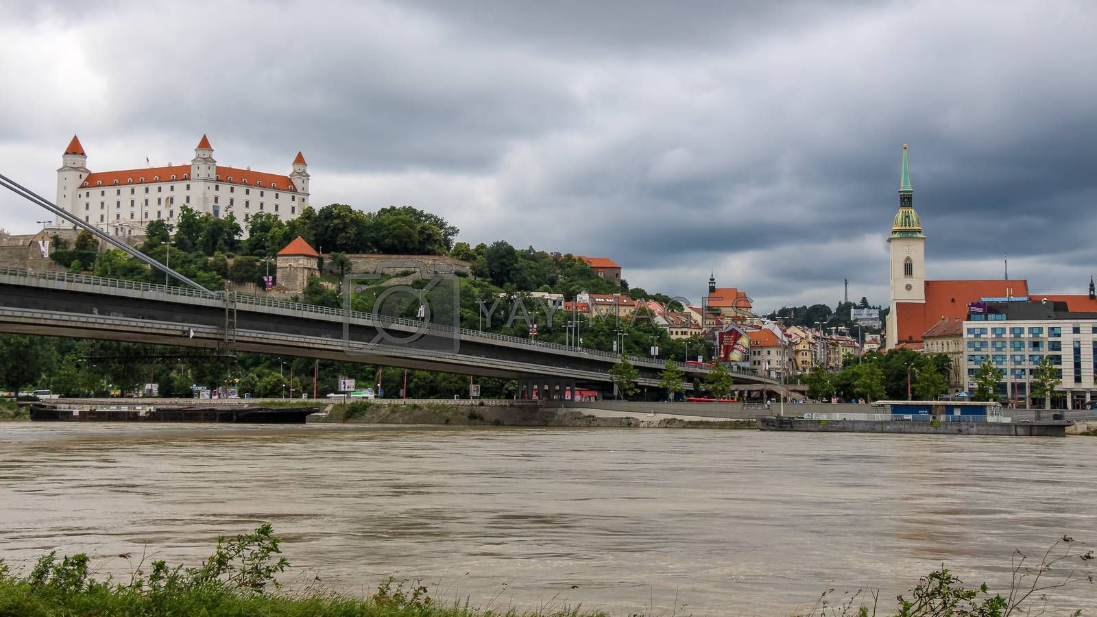 Bratislava, Slovakia - July 5th 2020: Bratislava Castle over looking the River Danube and the Most SNP Bridge, in the old town, Slovakia