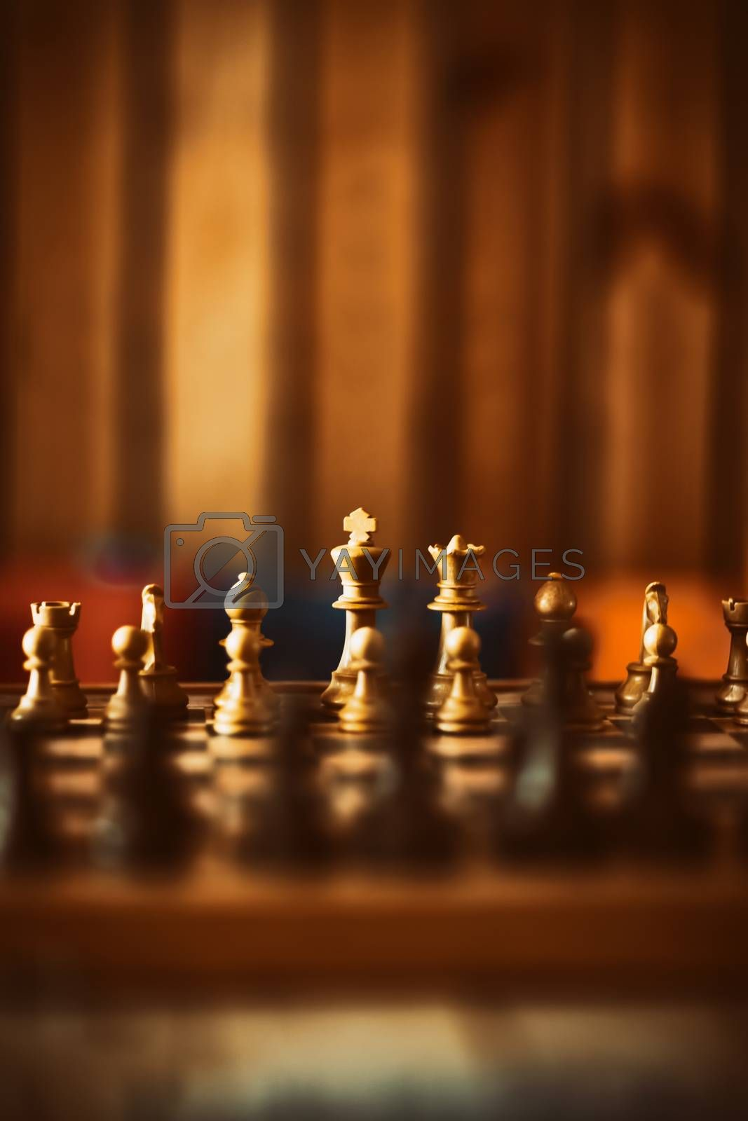 Game of Chess. Checkerboard with Figures on it in Soft Warm Room Light. Intellectual Sports. Intellectual Games.