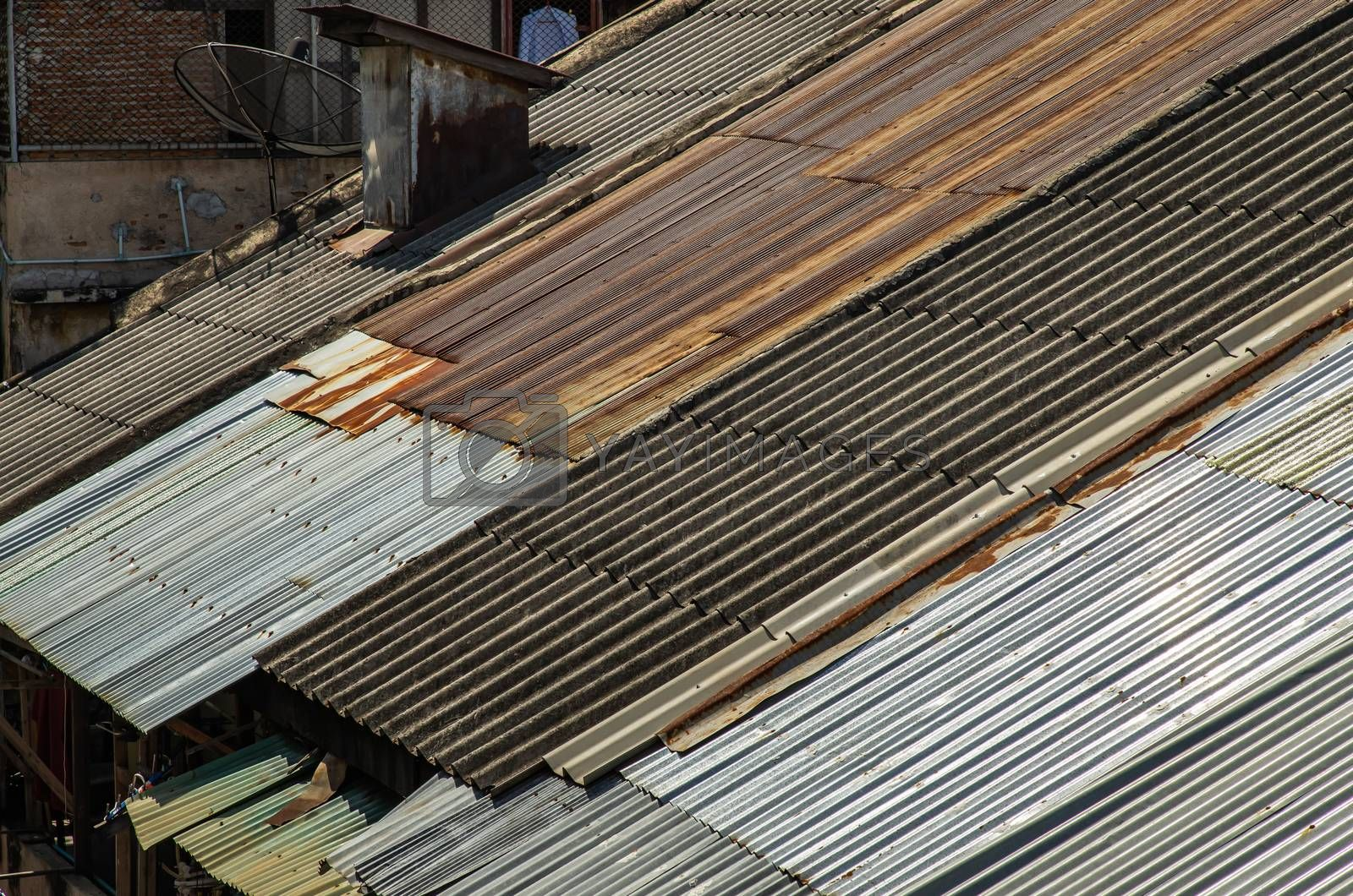 The Old galvanized roof and Old chimney roof on House, Old metal sheet roof texture, Rusty metal sheet texture. Selective focus.