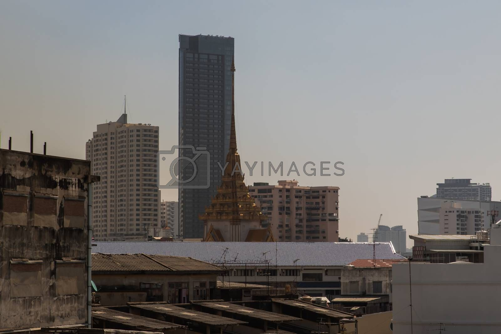 City view of Bangkok with Thai temple and modern tall buildings that perfectly coexist. No focus, specifically.