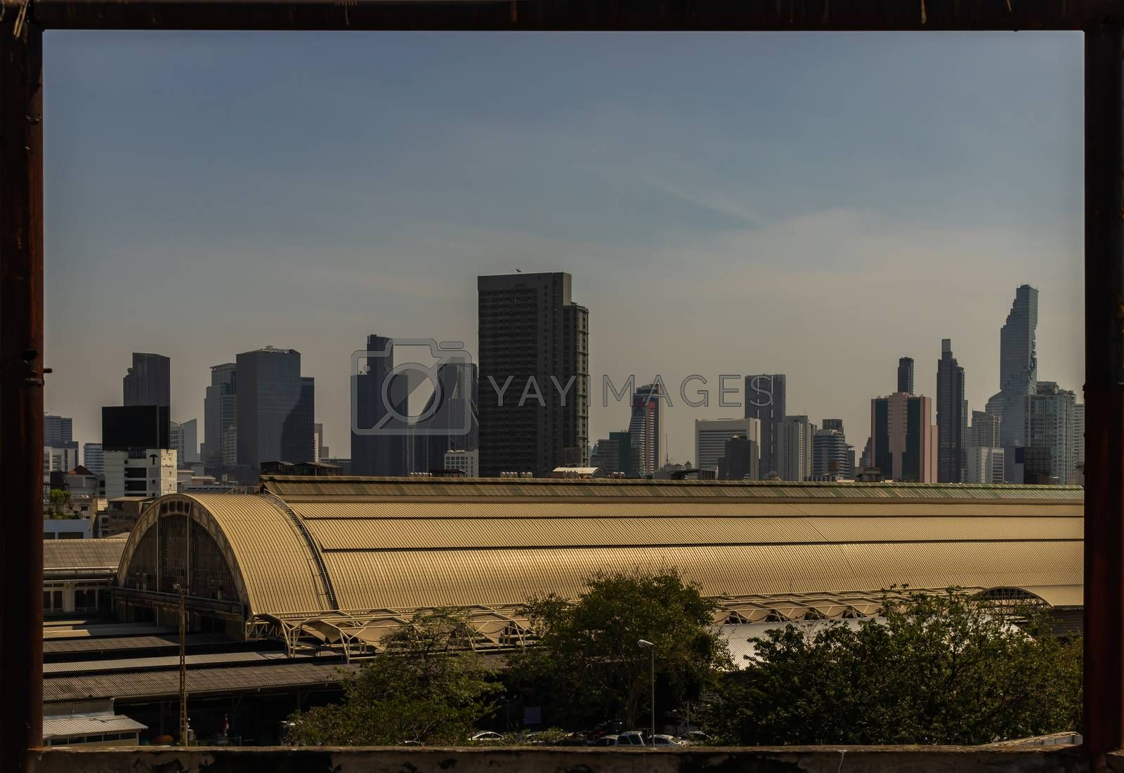 Roof of Hua Lamphong Station And the sky background of Bangkok. Looks through the Steel frame in abandoned building. No focus, specifically.