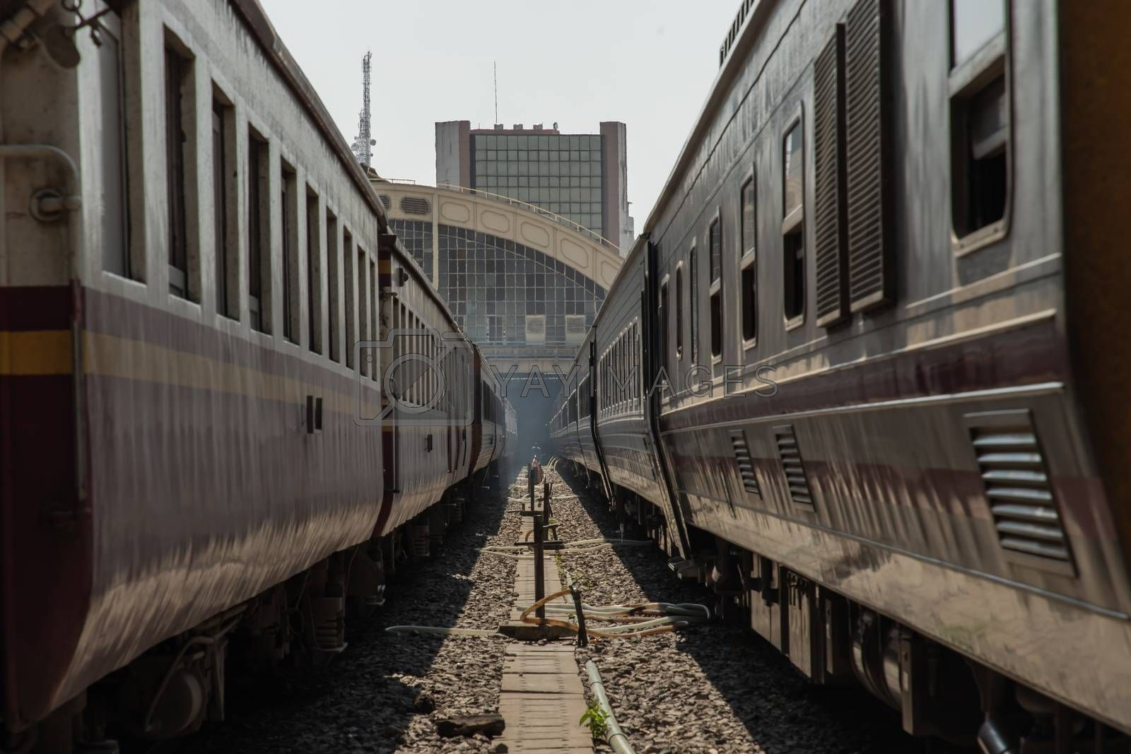 Two train is parked at platform waiting for passengers in hua lamphong railway station. the main railway station of Thailand located in the center of Bangkok. Focus and blur.