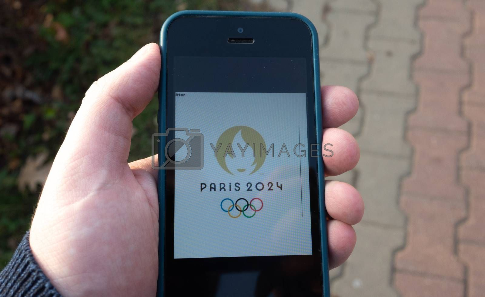 October 22, 2019.  Paris, France. Logo of the XXXIII  Summer Olympics games 2024 on a mobile phone screen.