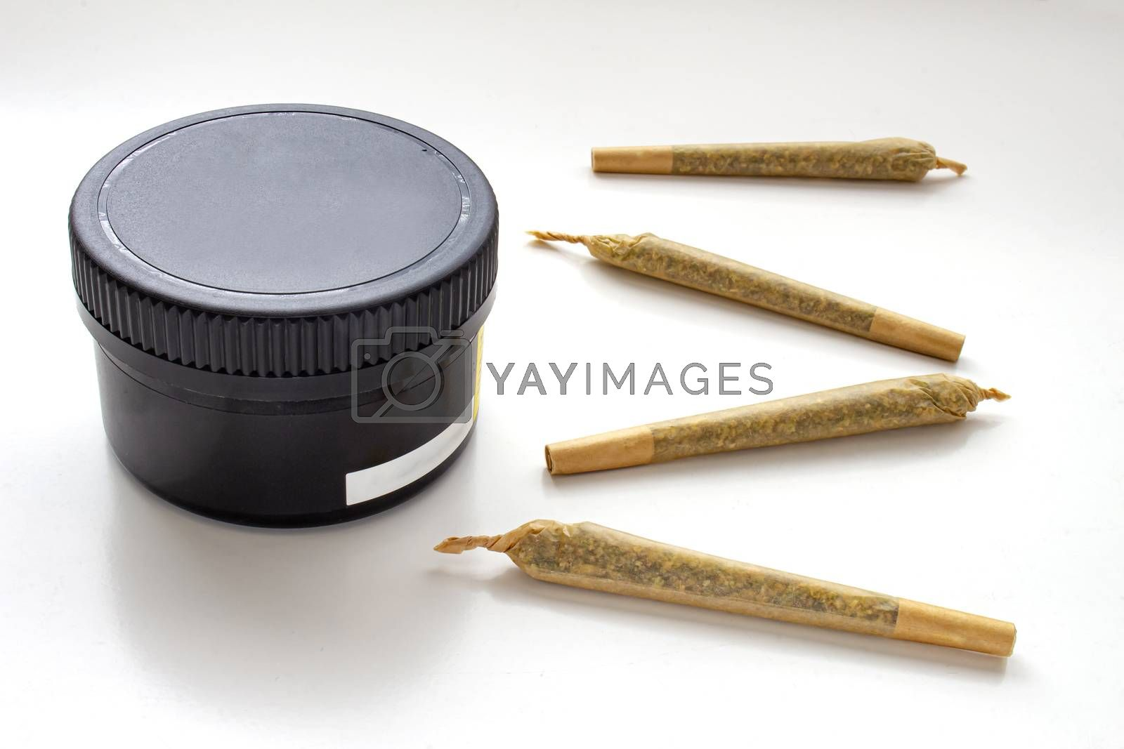 A Cannabis black plastic packaging container with Cigarettes, Prerolls or Joints on a white background