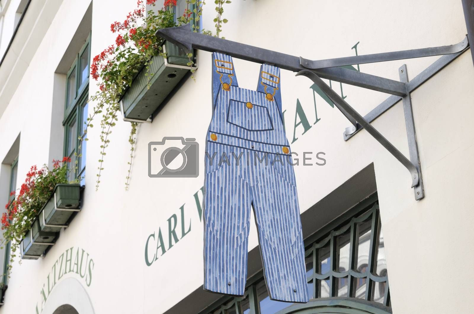 Shop sign in form of a dungarees.