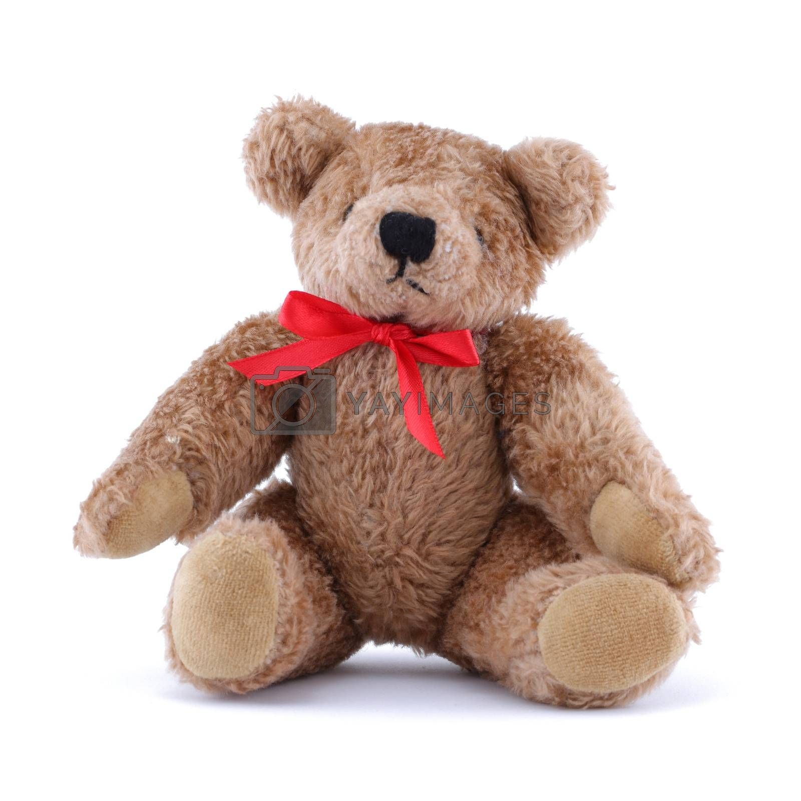 A Teddy bear with red ribbon sitting on white