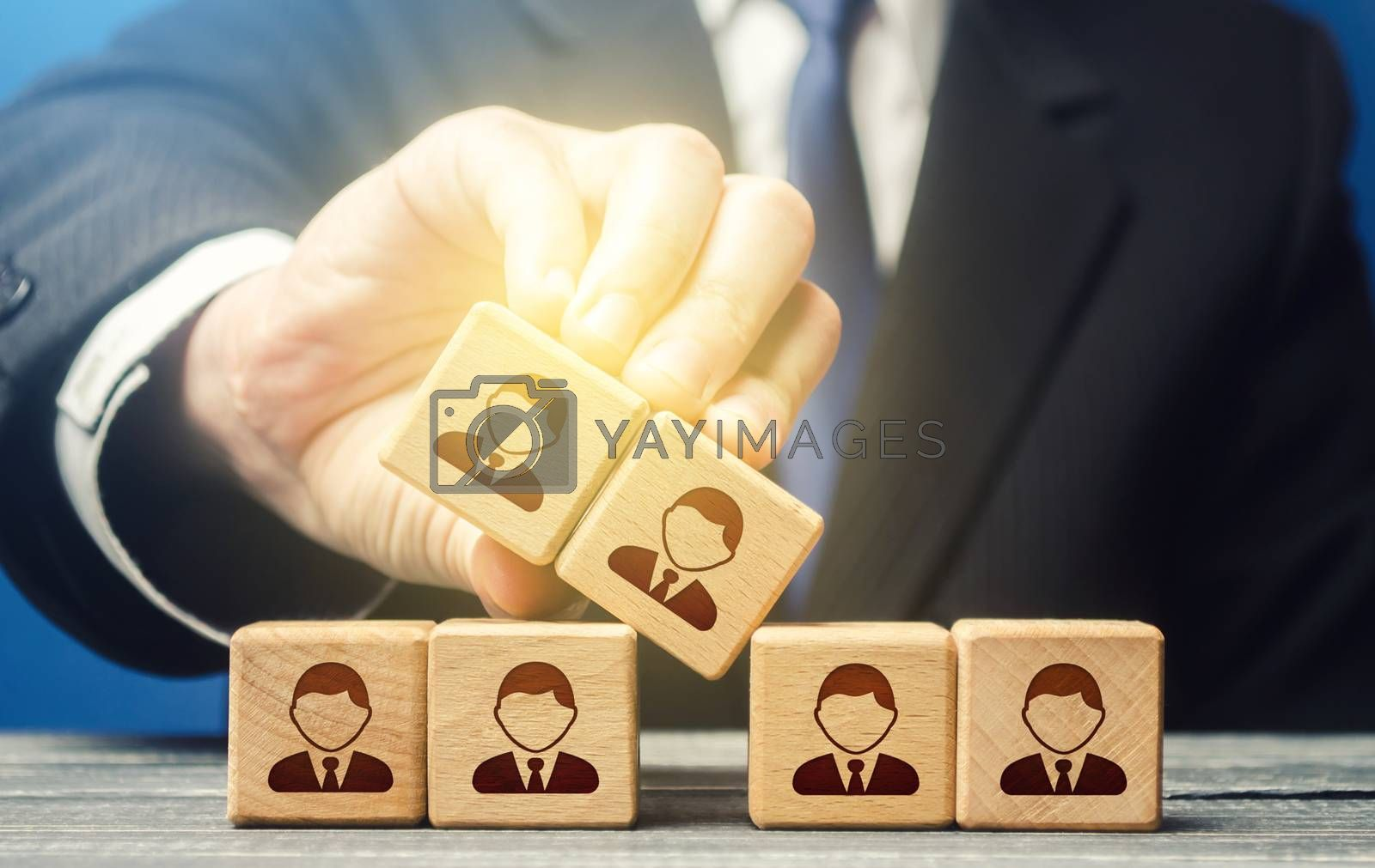 The man expands the team and adds new members. Company organization. Hiring workers. Leadership skills, team personnel management. Recruiting fresh employees for a large project. Accession cooperation