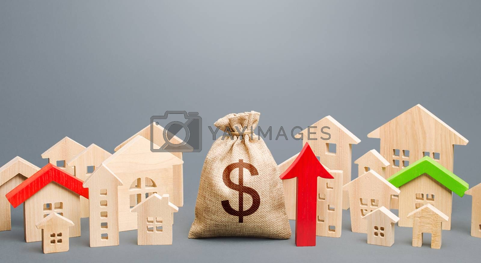 Dollar money bag and a city of house figures and red up arrow. Recovery and growth in property prices, high demand. Increase in rent. Increase in revenues to municipal budget. Investments.