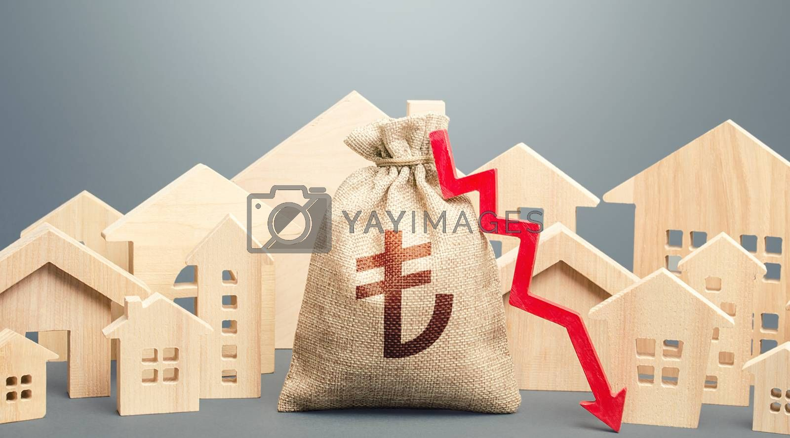 City residential buildings and turkish lira money bag with a red down arrow. Low demand for home buying. Lower mortgage interest rates. Falling prices for rental apartments. Low cost real estate.