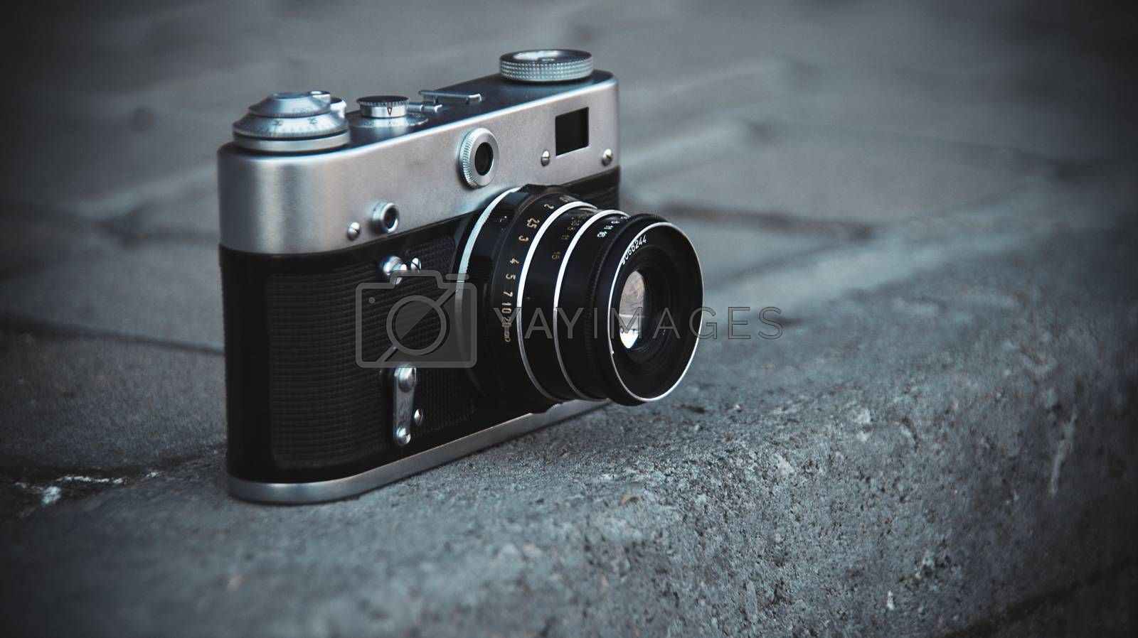 The old film camera is on the ground