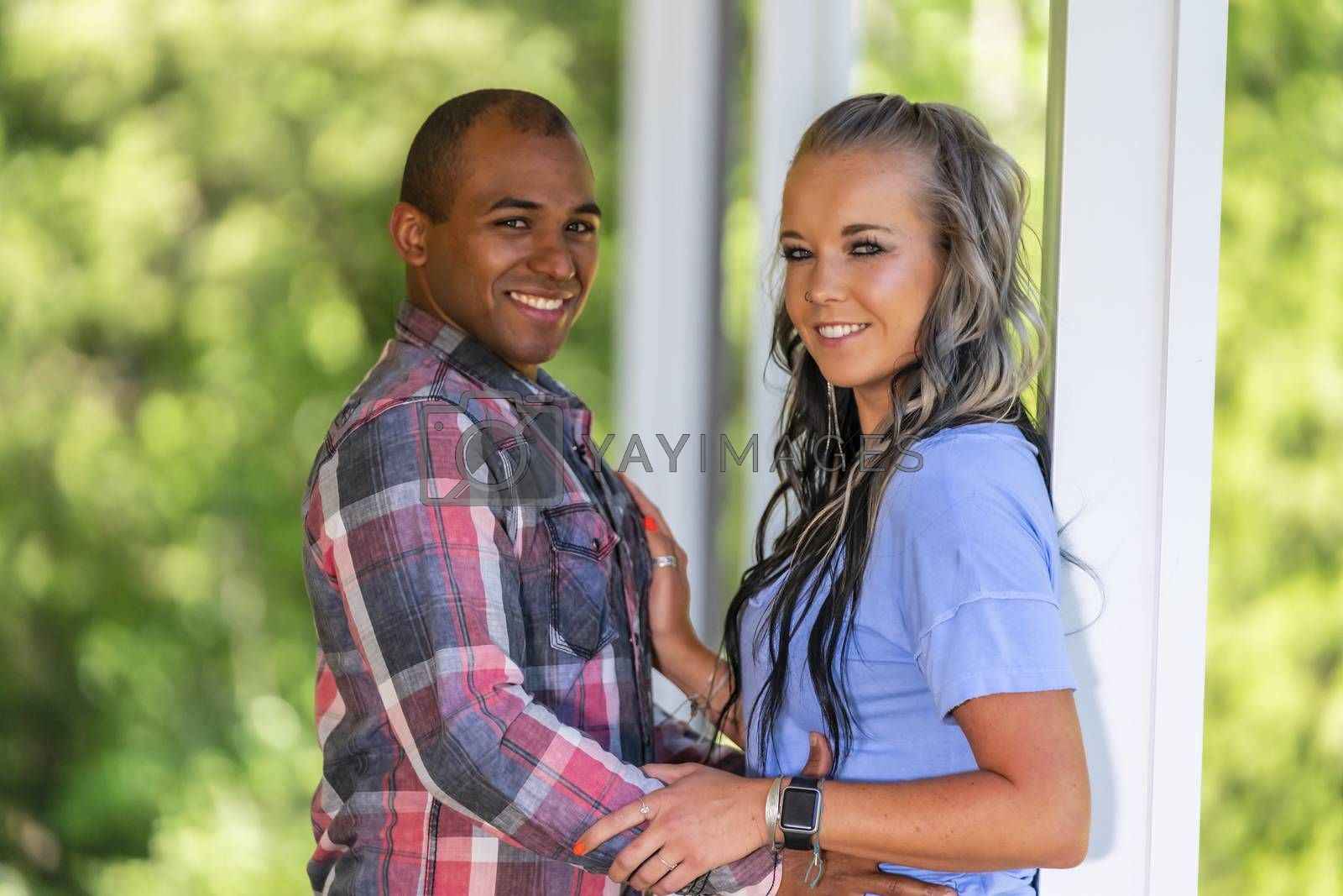 An interracial couple enjoying each others company on a summers day