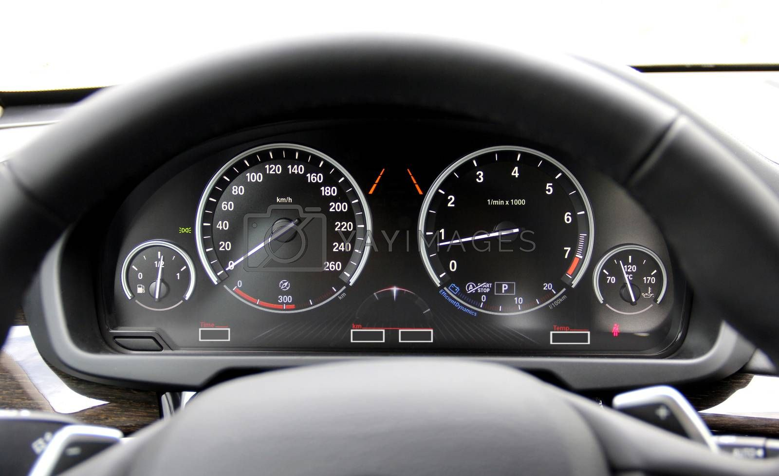 Royalty free image of car illuminated dashboard in a hybrid car by aselsa