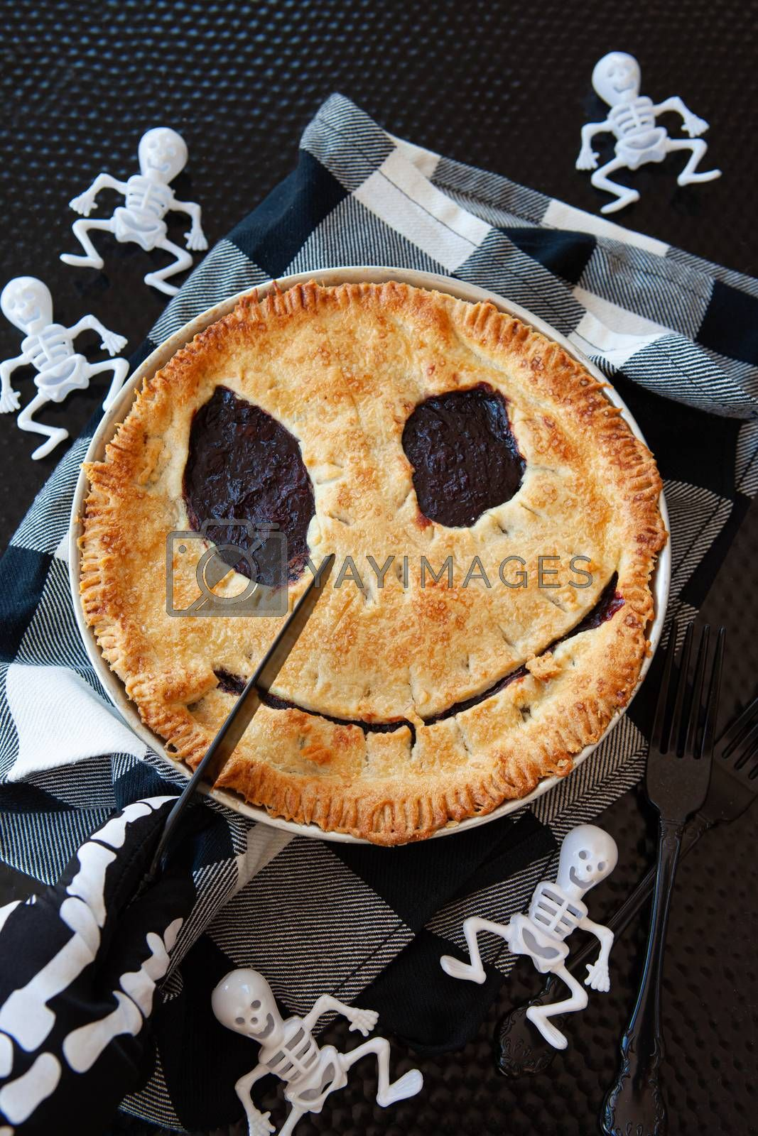 Homemade cherry pie with a scary face for Halloween