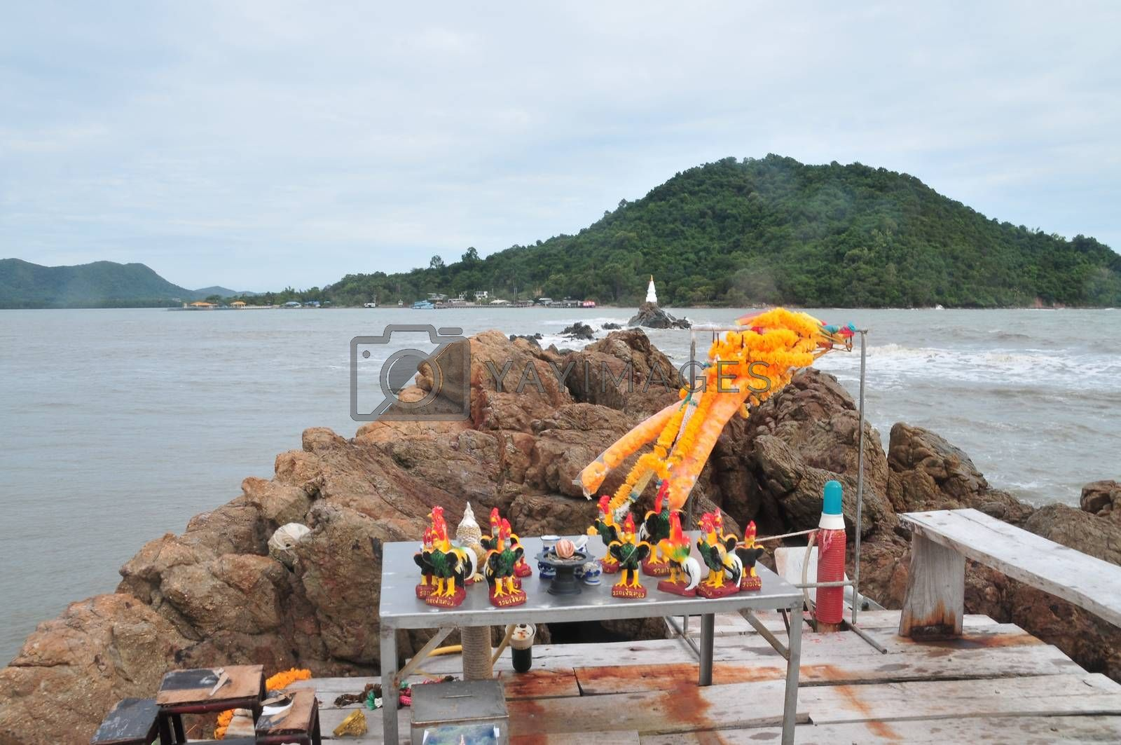 CHANTABURI, THAILAND – 4 AUGUST 2019 : Chedi Ban Hua Laem  There is a wooden bridge that goes out into the sea to see the Chedi that situated in the middle of the water.