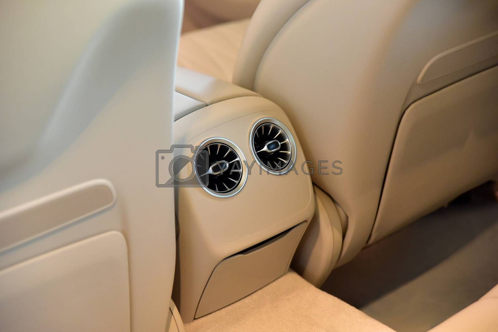 Royalty free image of Rear passenger air vent of modern luxury car by aselsa