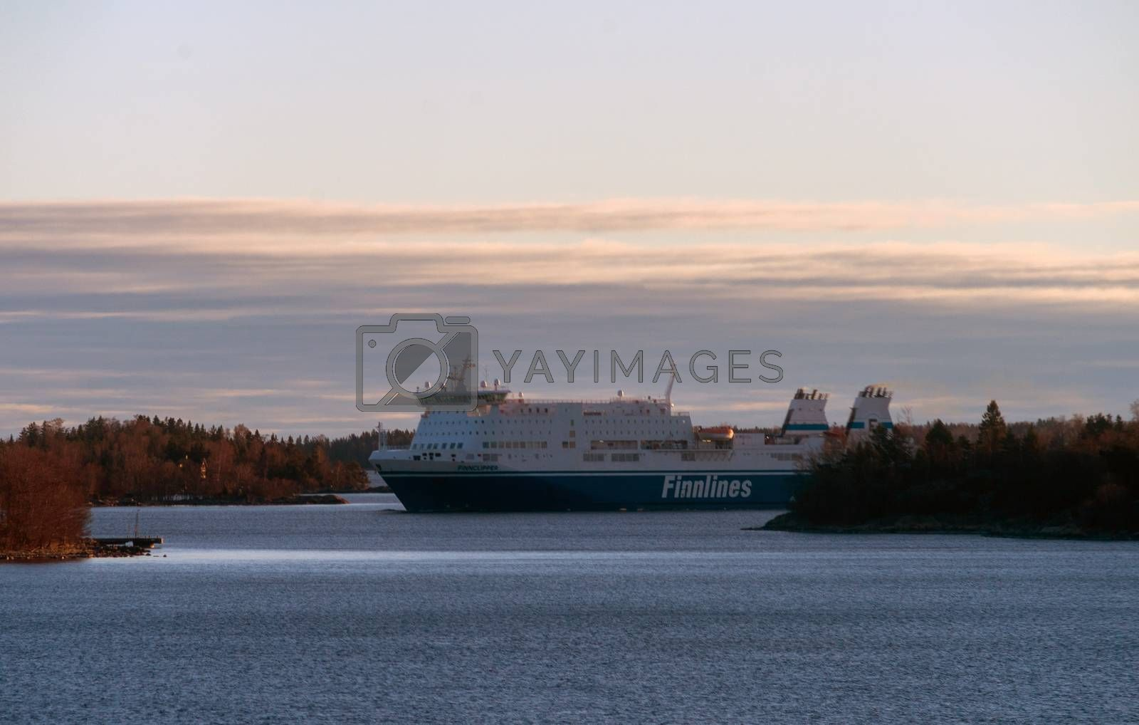 22 April 2019, Stockholm, Sweden. High-speed passenger and car ferry of the Finnish shipping concern FINNLINES Finnclipper equipped with rotary sail in Stockholm skerries.
