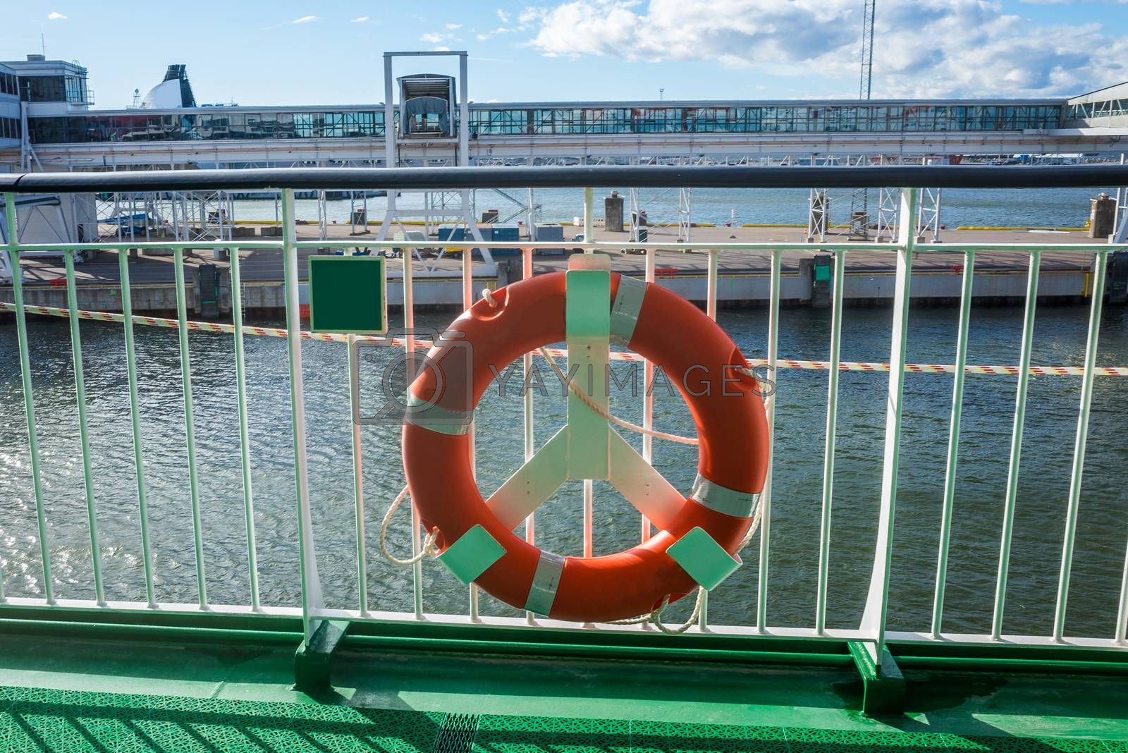 Lifebuoy on the railing of one of the decks of a tourist ferry