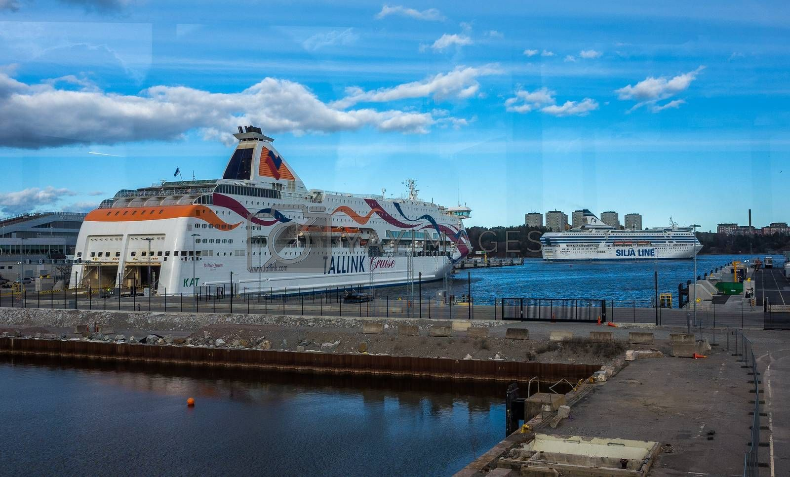 22 April 2019, Stockholm, Sweden. High-speed passenger and car ferrys of the Estonian shipping concern Tallink Silja Europa and Baltic Queen in the port Vartahamnen in Stockholm.
