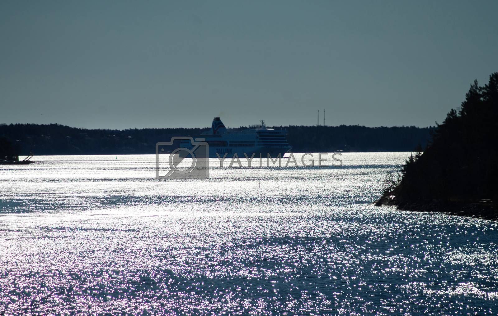 22 April 2019, Stockholm, Sweden. High-speed passenger and car ferry of the Estonian shipping concern Tallink Romantika  equipped with rotary sail in Stockholm skerries.