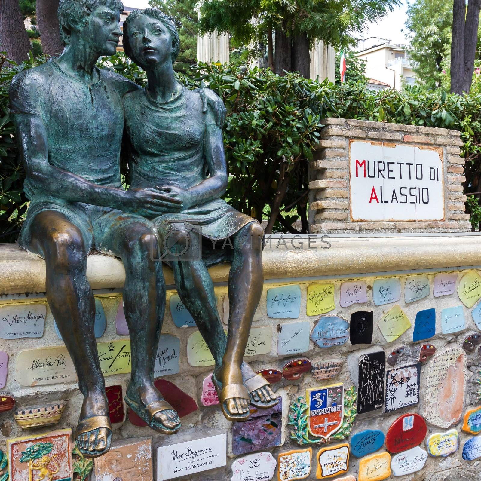 Italy. Muretto di Alassio. The famous Little Wall in Alassio with the bronze statue of the lovers. Alassio (SV), ITALY - August 22, 2017.