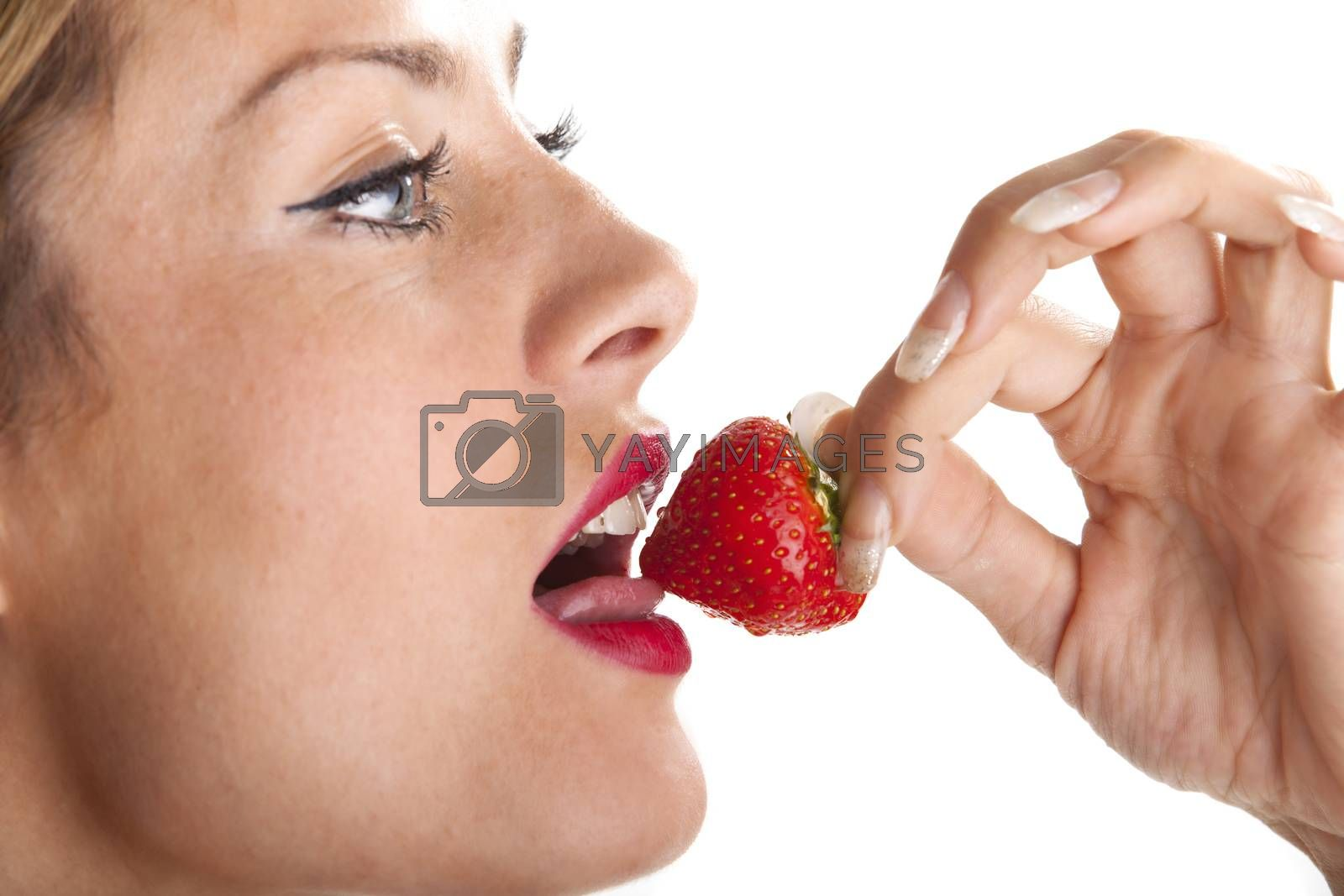 woman eating a strawberry