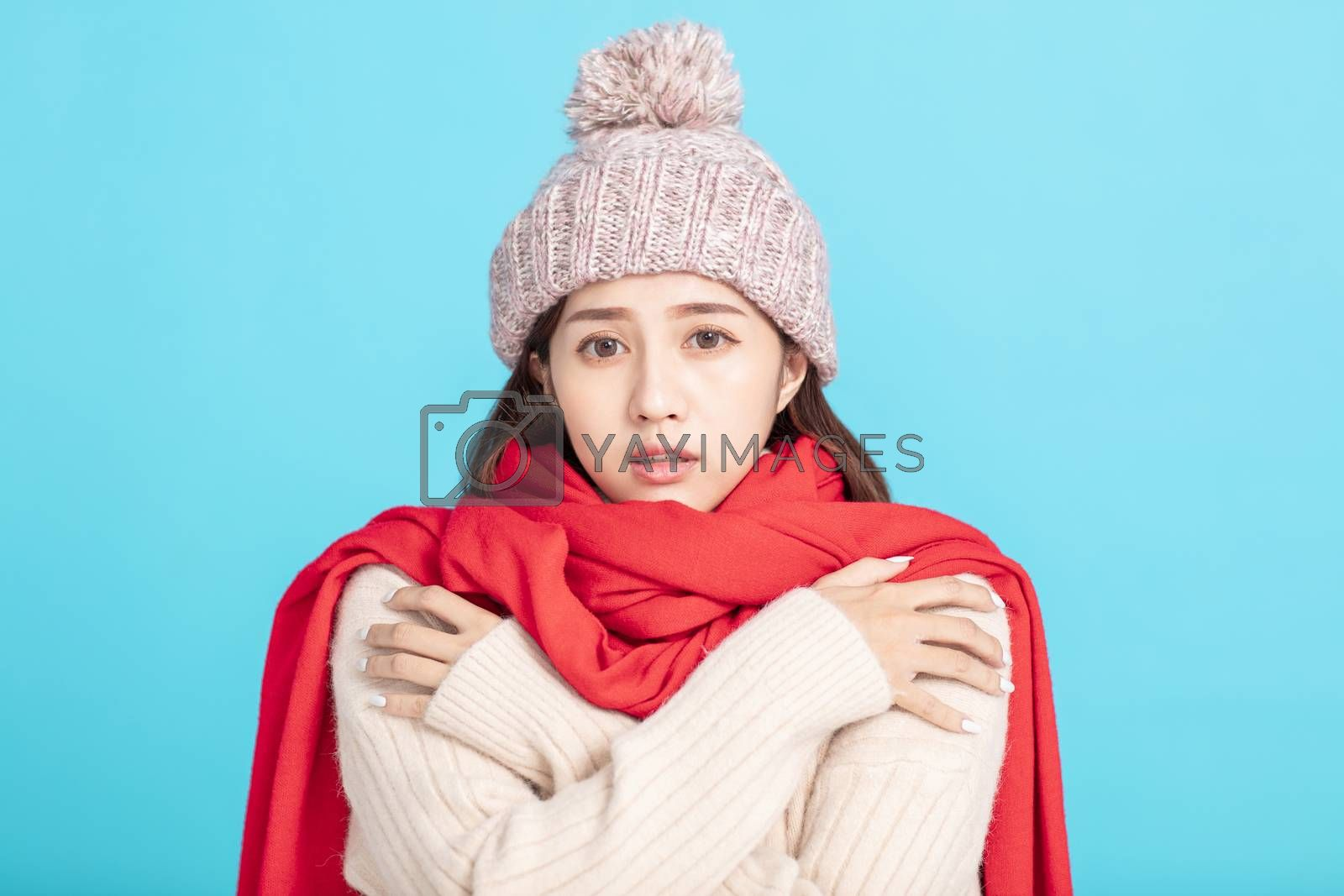 freezing young woman in winter cloth