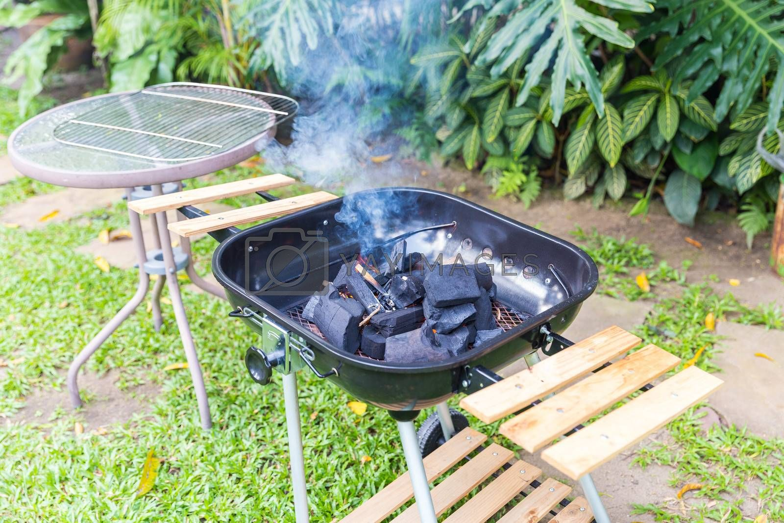Fire coal in barbecue grill ready for cook in an outdoor backyard
