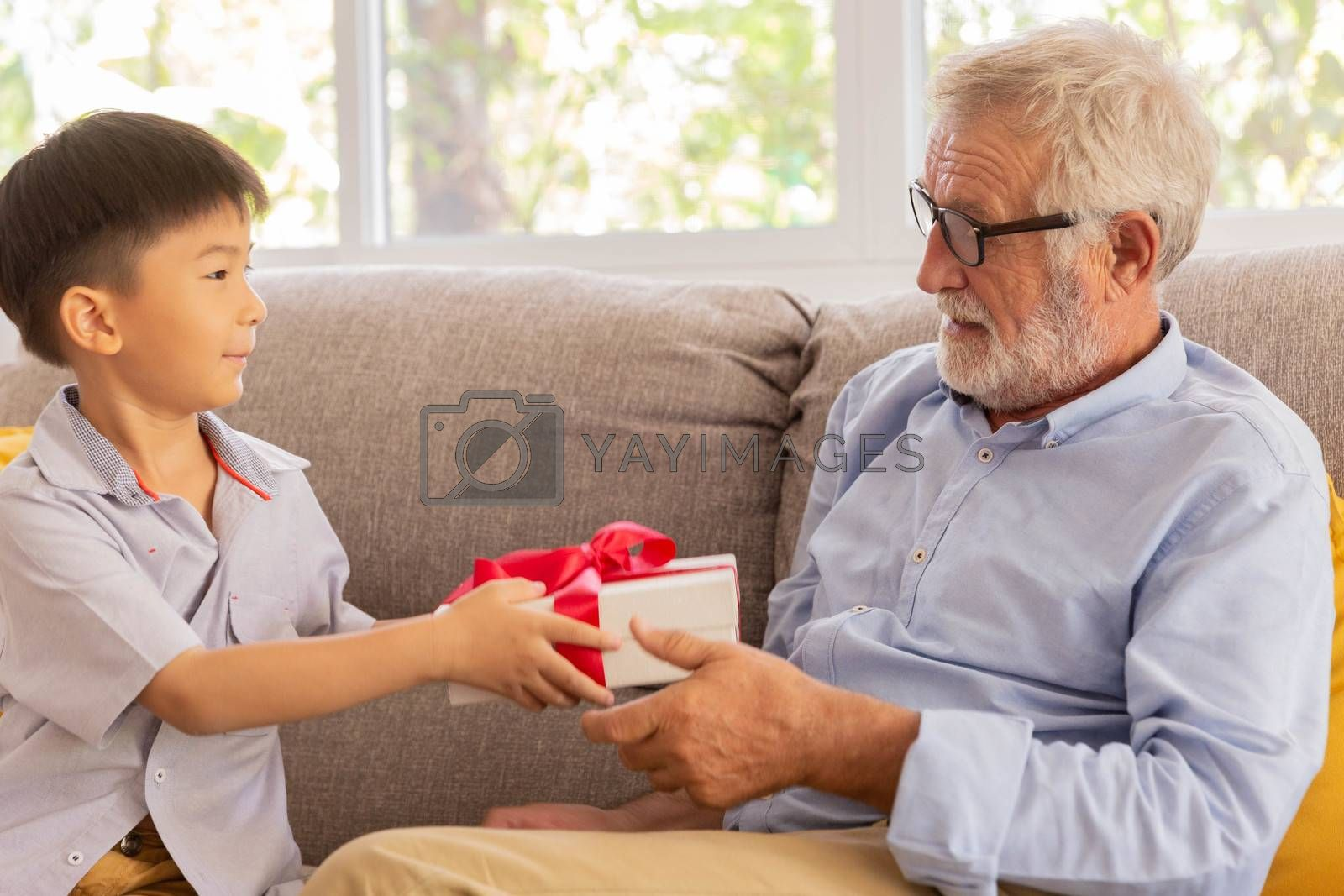 Senior retirement man is happy with his surprise birthday gift from grandson