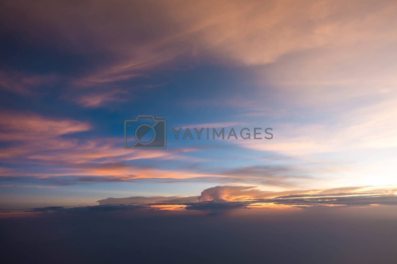 Sunset sky during twilight from airplane window