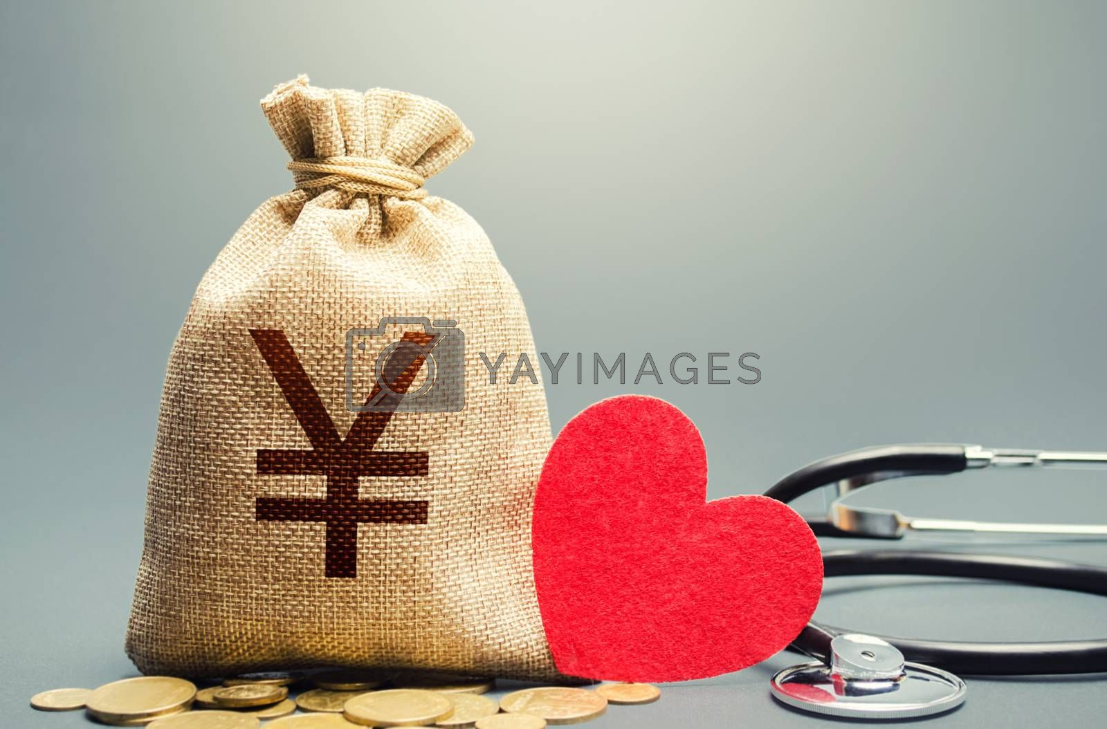 Yen Yuan money bag and stethoscope. Health life insurance financing concept. Funding healthcare system. Reforming and preparing for new challenges. Development, modernization. Subsidies, investments