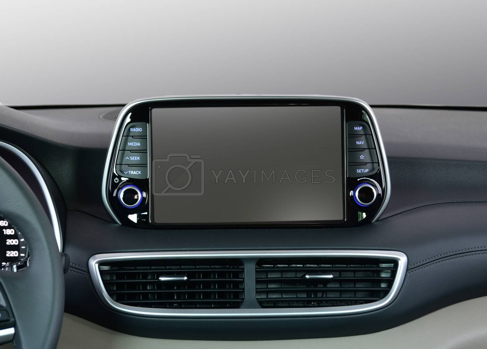 Royalty free image of Screen multimedia system on dashboard in a modern car by aselsa