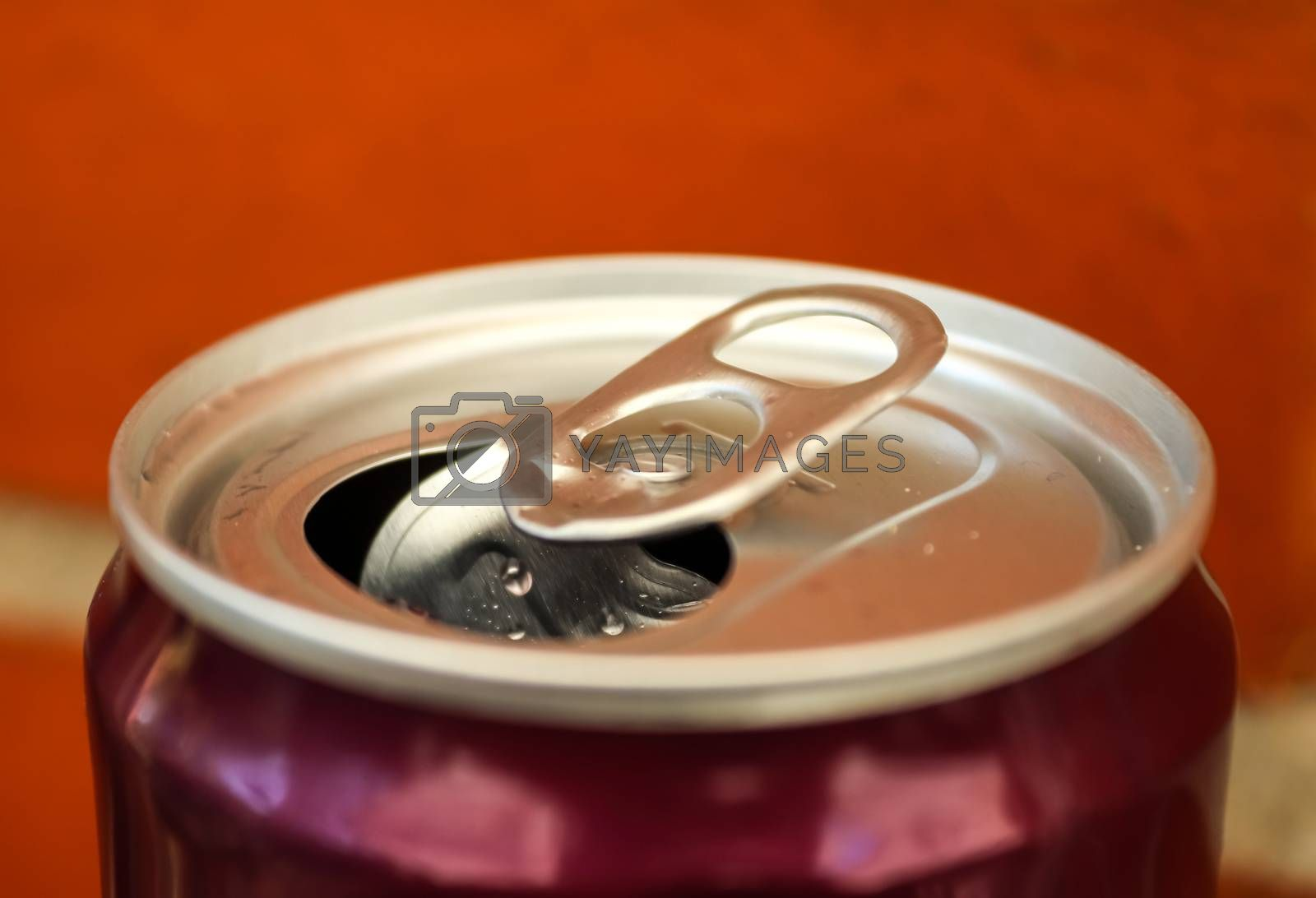 Top view up a can of soft drink isolated on wooden background