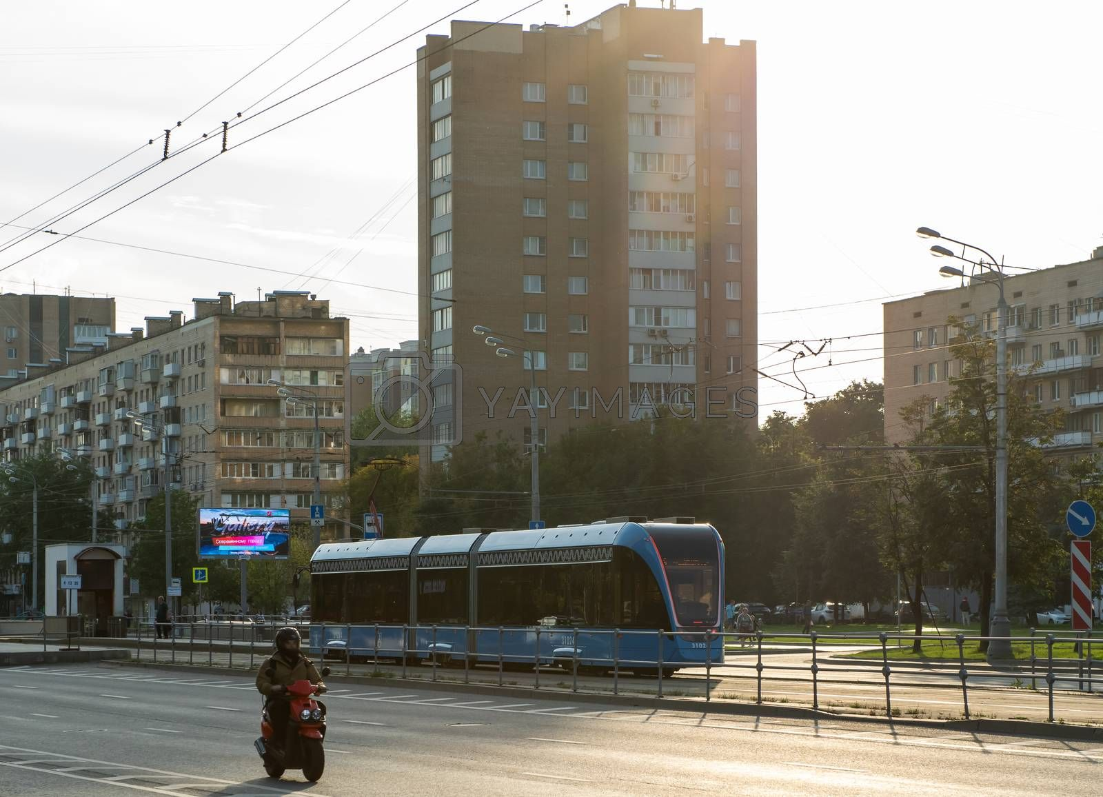 August 14, 2019, Moscow, Russia. Tram and scooter on Bolshaya Cherkizovskaya street in Moscow.