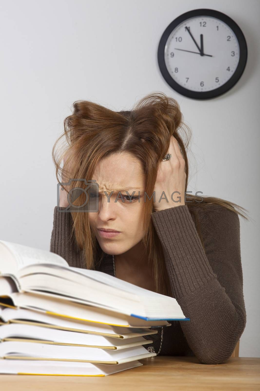 student with books and a clock