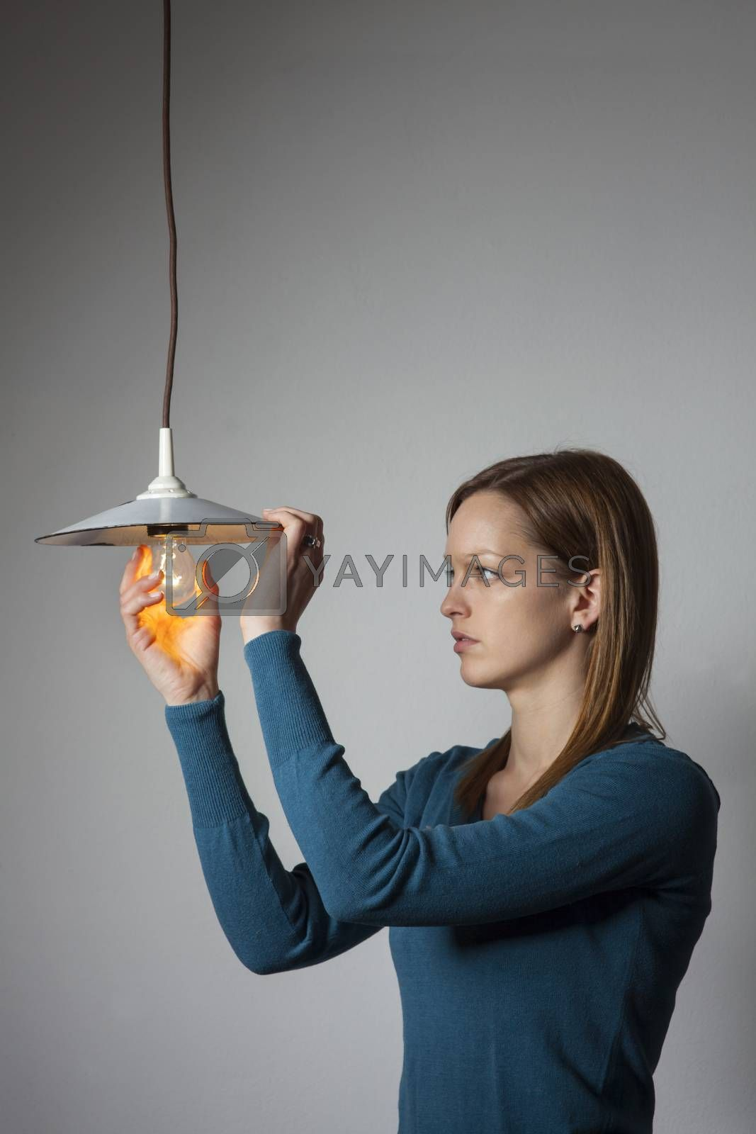 woman with a light bulb on white
