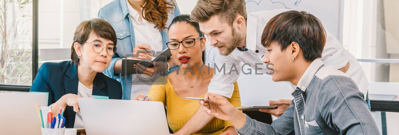 Banner and web page or cover template of Group Of Asian and Multiethnic Business people with casual suit working and brainstorming together with technology computer in the modern Office,