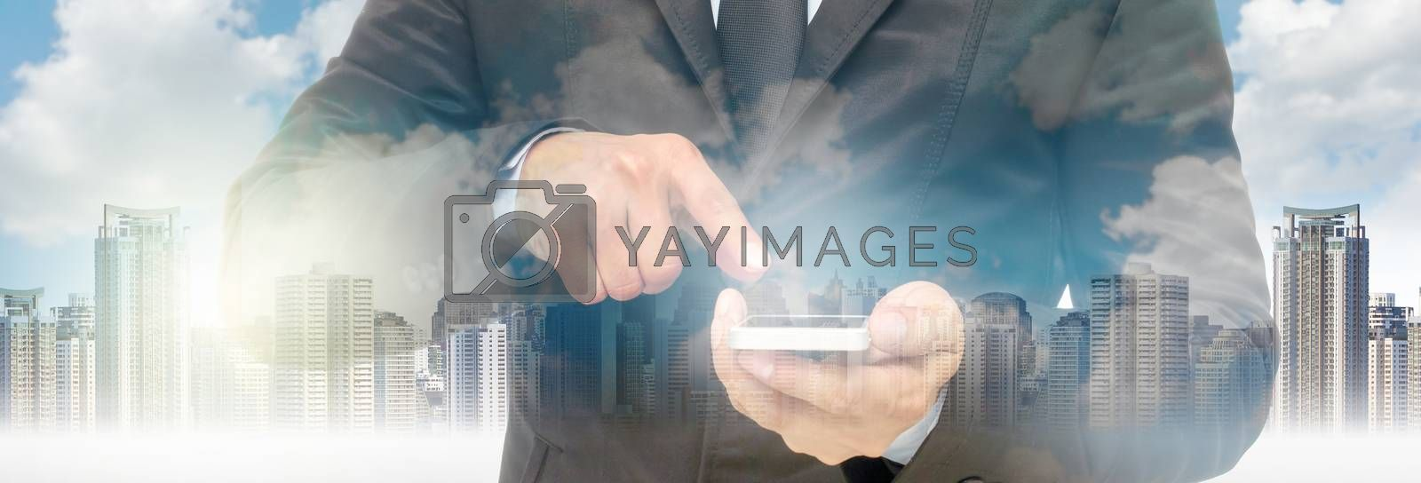 Double exposure of businessman using the smart phone on cityscape background, business for Banner and web page or cover template concept