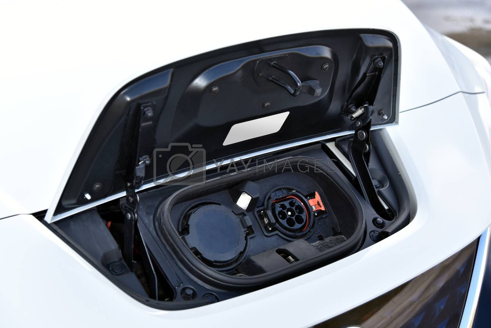 Royalty free image of Charging port on a modern electric car by aselsa