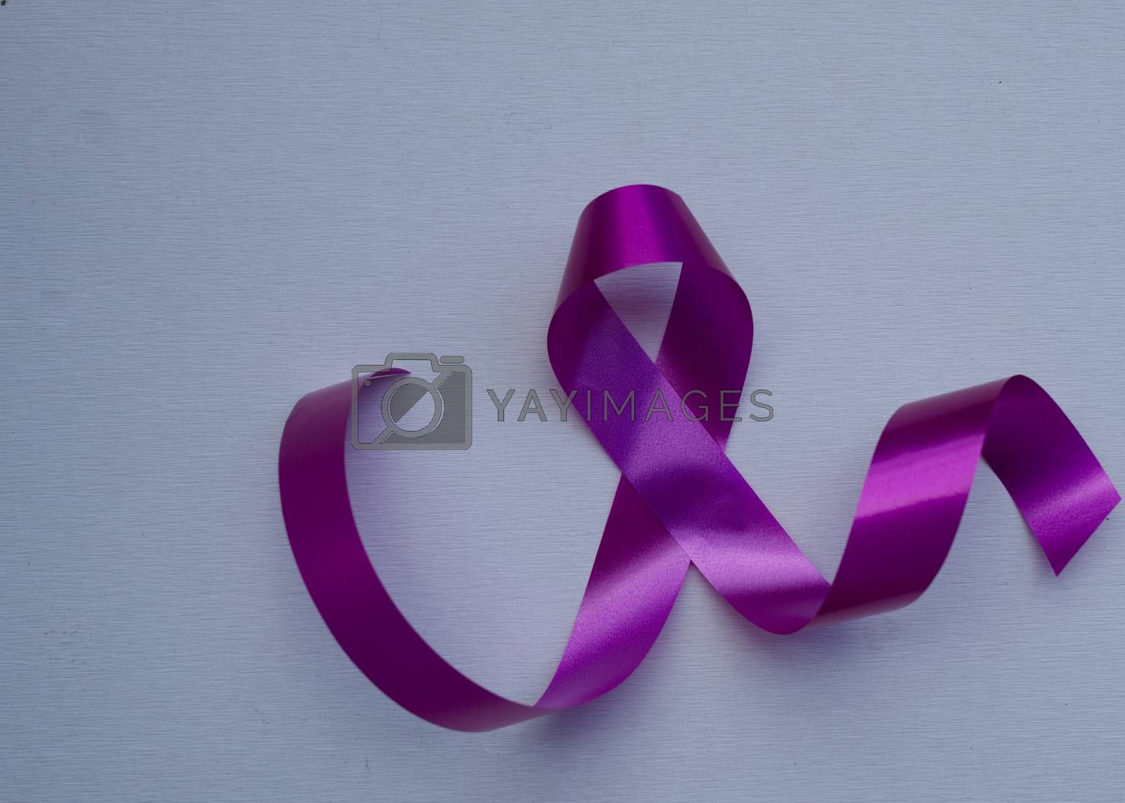 Close-up pink ribbon breast cancer awareness day campaign symbol isolated white background.