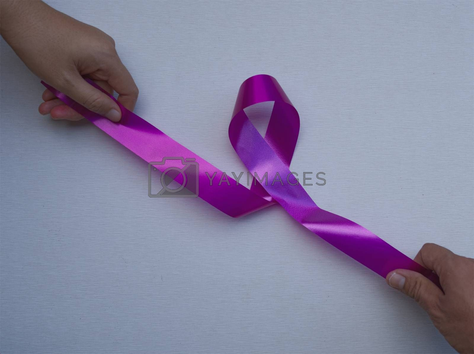Abstract women hands and men hands pulling pink ribbons expressing breast cancer awareness day concept isolated pink background.