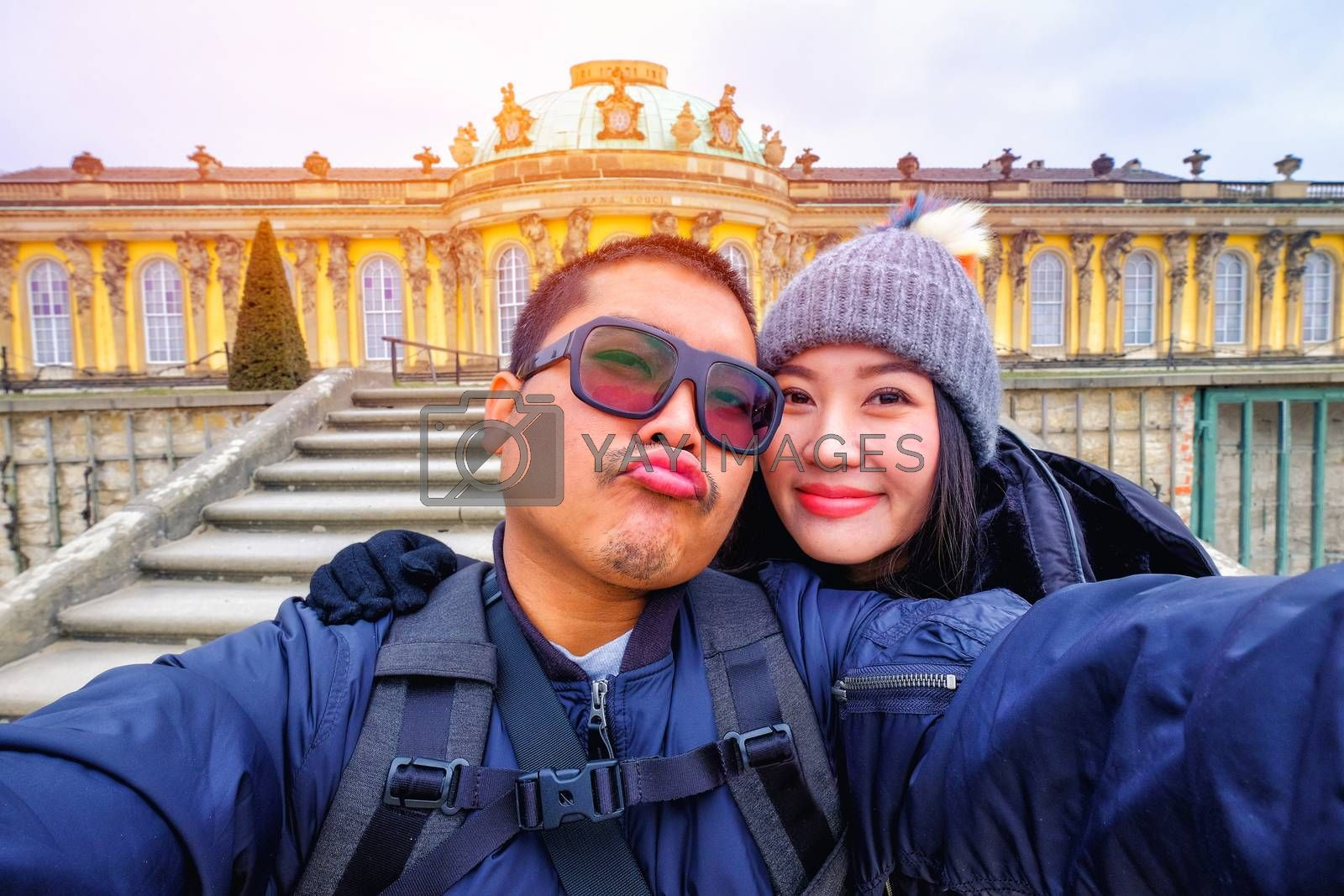 Young Couple Tourists selfie with smartphone at Sans Souci palace in Potsdam, Berlin, Germany