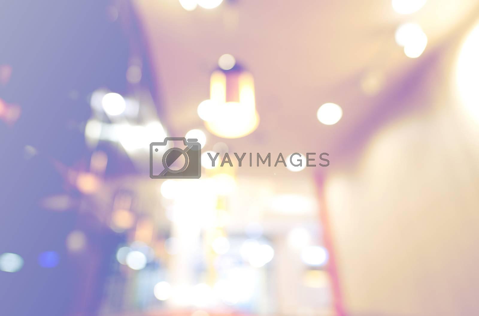 Blurred background image shop lamp caffeine tones purple yellow.
