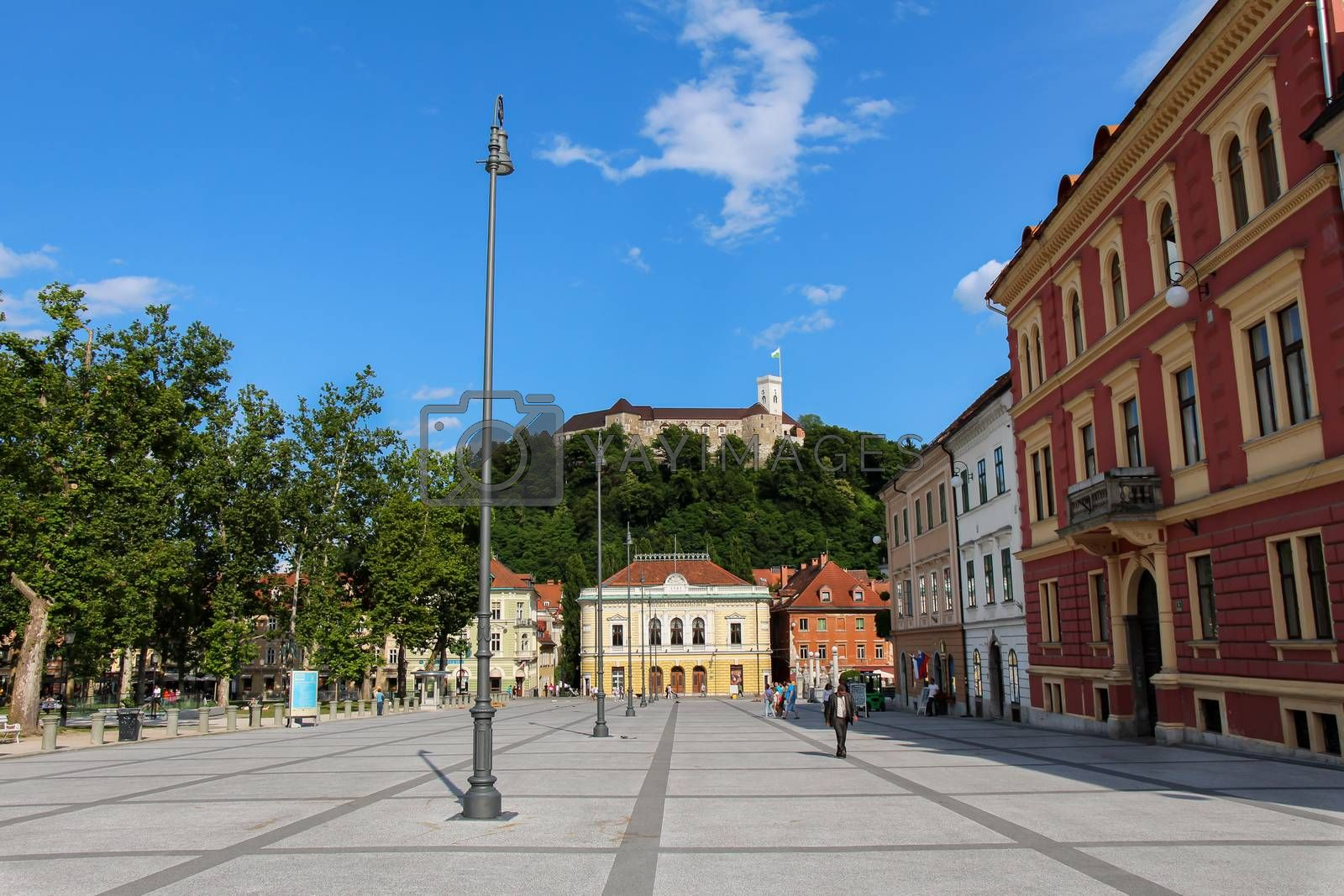 Ljubljana, Slovenia - July 16th 2018: Ljubljana, Slovenia - July 16th 2018: The park at Congress Square in the center of Ljubljana on a summers day, Slovenia, with the Slovenian Philharmonic Building in the background