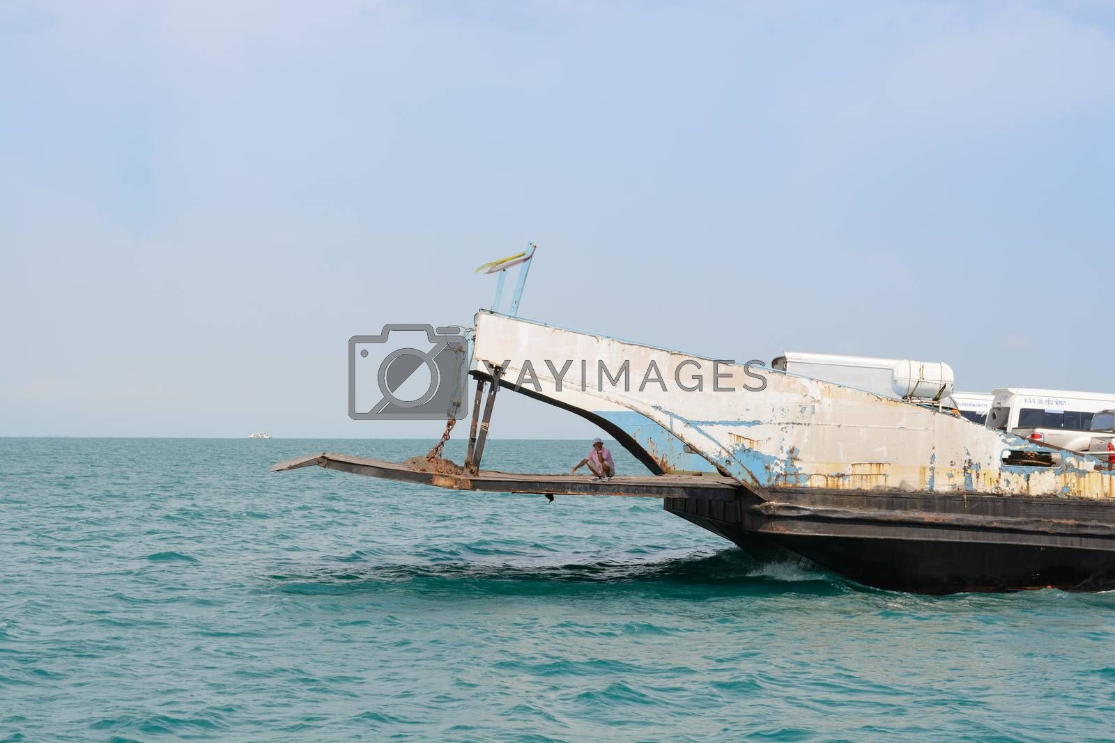 Trat, Thailand-April 29, 2015: Tourists and Cars loaded on ferry boat and heading to Koh Chang Island on April 29, 2015 in Koh Chang Island, Trat, Thailand. . Koh chang Is the second largest island of Thailand.