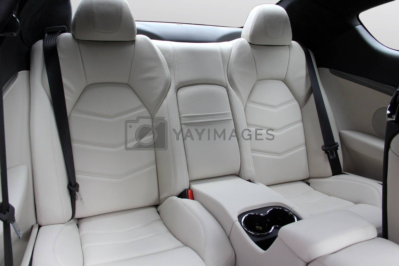 Royalty free image of The white rear seat of a luxury sports car by aselsa