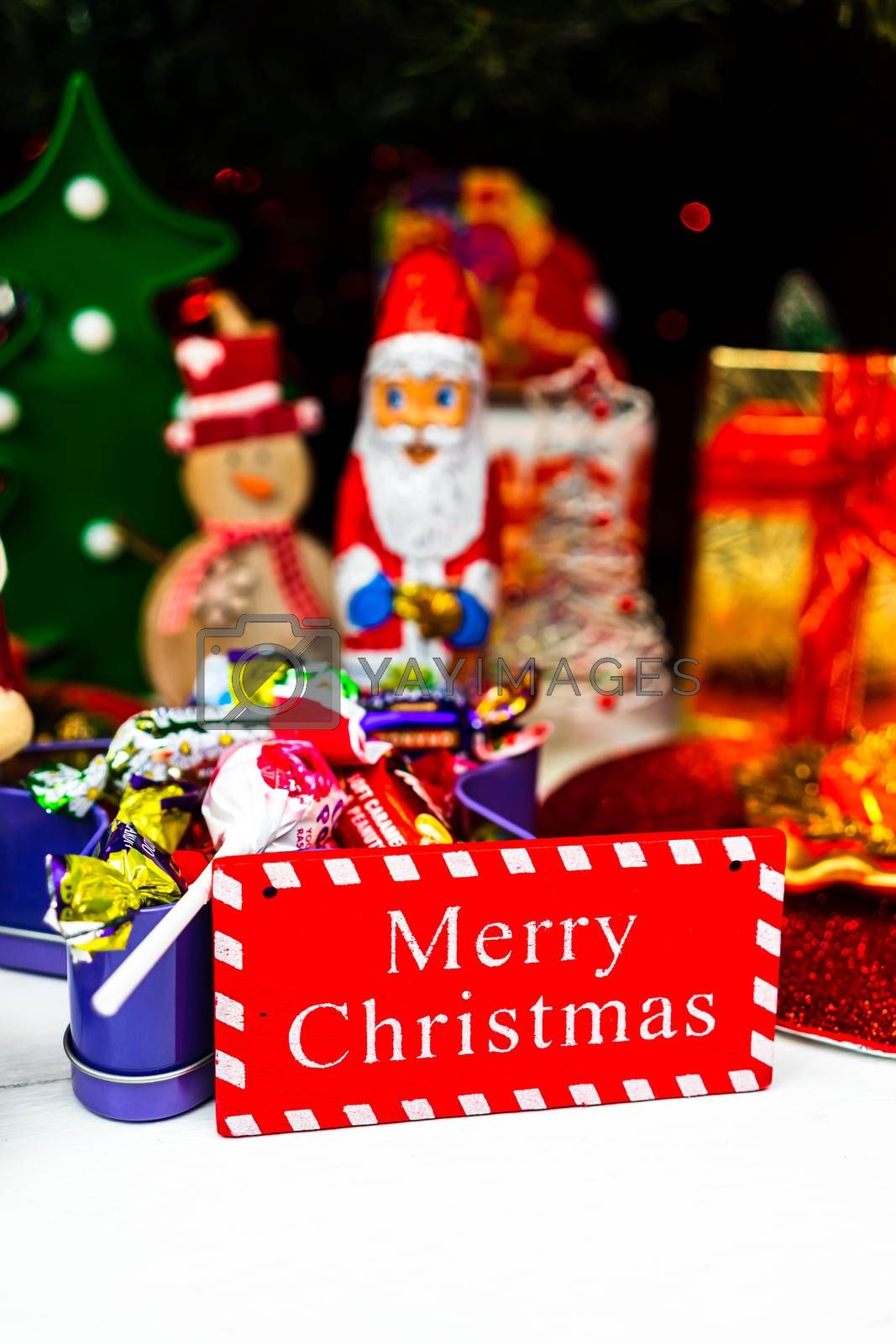 Christmas ornaments decorations and gifts under the  Christmas tree.