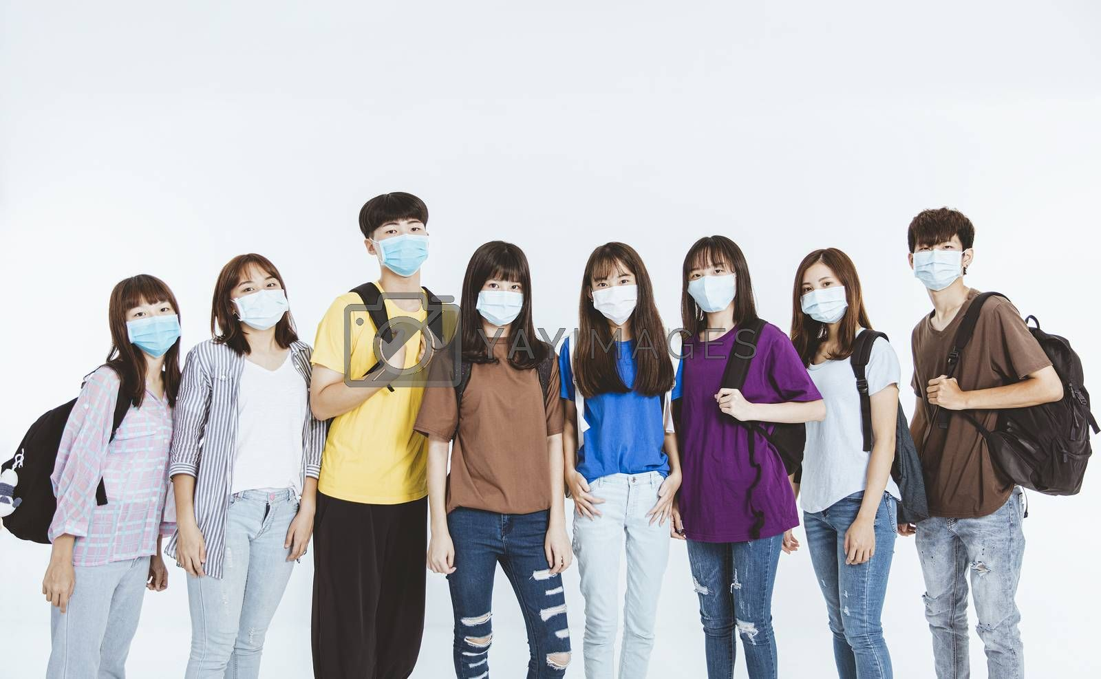 young student group wearing protective medical face masks standing together