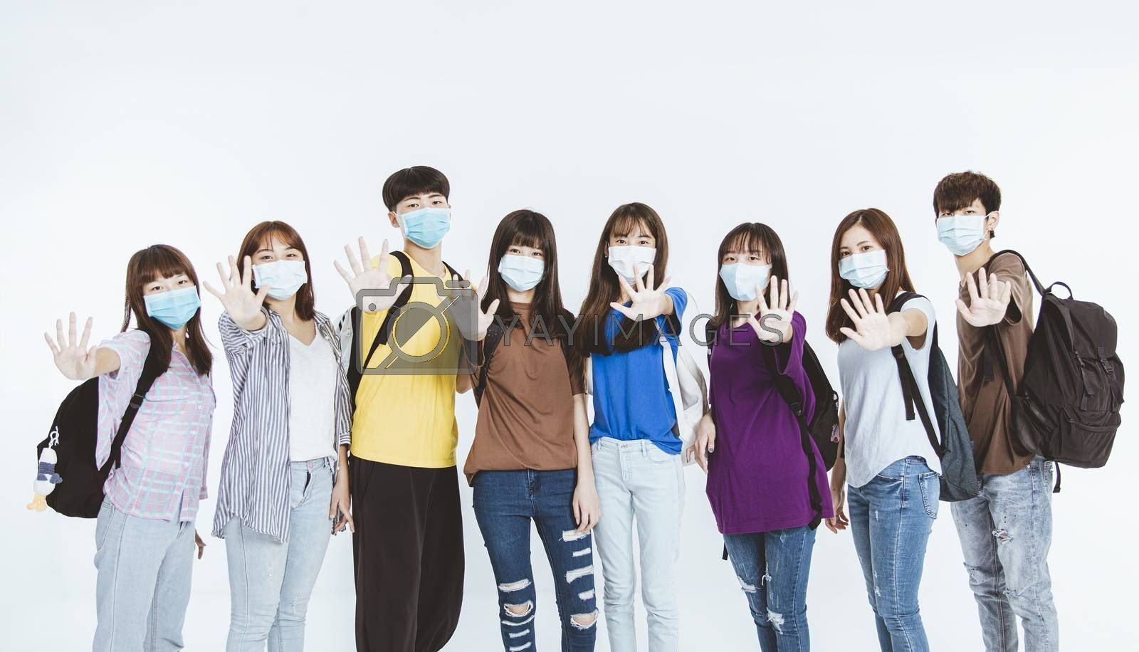 young student group wearing protective medical face masks standing together with stop gesture