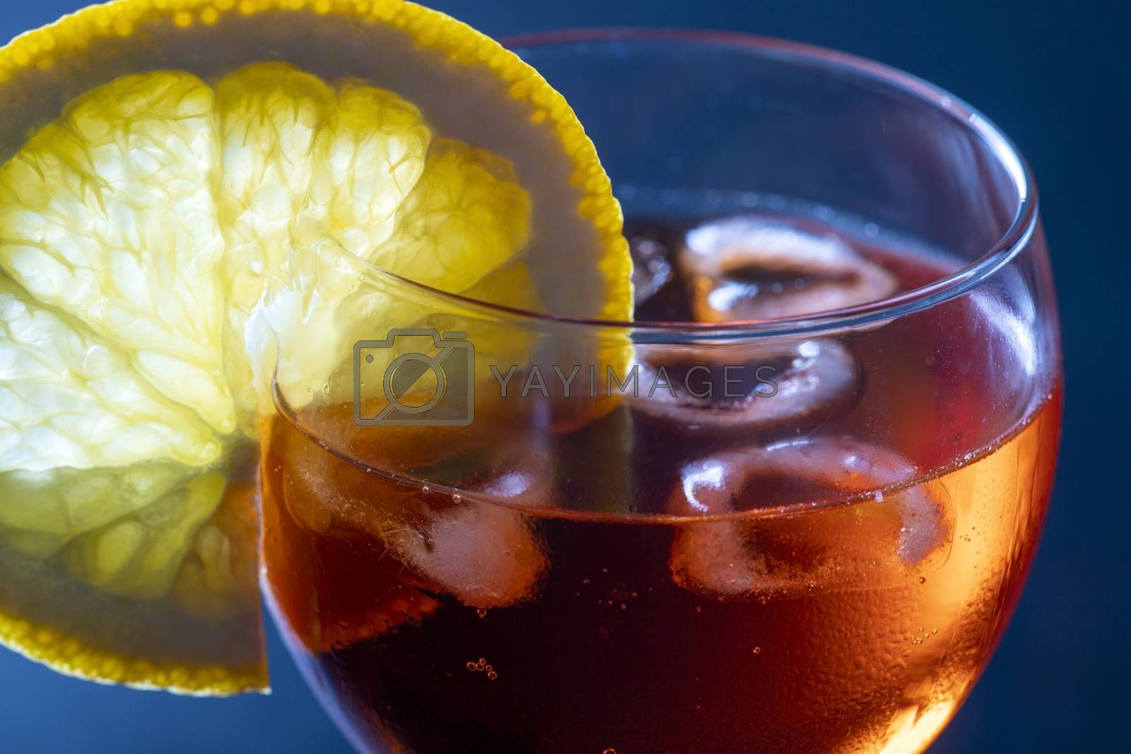 italian spritz in a glass on black